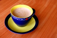 A cup of capuccino. Stock Photos