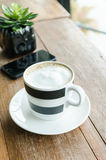 Cup of capuccino and smart phone Stock Image
