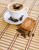 Cup of capuchino with coffee beans and cookie Stock Images