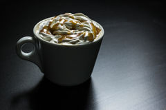 Cup of caramel cappuccino coffee stock photo
