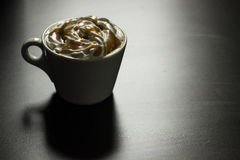 Cup of caramel cappuccino coffee stock images