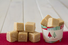 Cup of Caramel Fudge Christmas Gift with Stack on Side Royalty Free Stock Photography