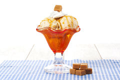Cup of caramel ice cream Royalty Free Stock Images