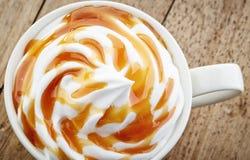 Cup of caramel latte Stock Photos