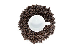 Cup on center coffee beans. And white background royalty free stock photography