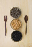 Cup of cereal grain seeds and napkin,spoon ,fork Stock Images