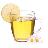 Cup of chamomile tea with chamomile flowers and lemon isolated Stock Images