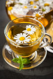 Cup of chamomile tea Stock Images