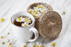 Cup of chamomile tea. Chamomile tea in a white cup Royalty Free Stock Photos