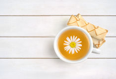 Cup of chamomile tea Royalty Free Stock Images