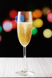 Cup of champagne on city lights background Royalty Free Stock Photo