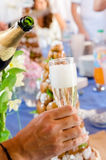 Cup of Champagne. And wedding cake Royalty Free Stock Photo
