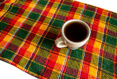 Cup on a checkered napkin Royalty Free Stock Images