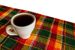 Cup on a checkered napkin Stock Image