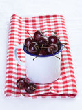 Cup of cherries Stock Images