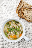 Cup of chicken soup Royalty Free Stock Photos