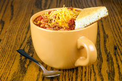 Cup of chili with cornbread Stock Images