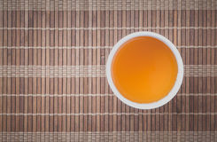 Cup of Chinese hot tea on bamboo mat Stock Image