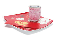 Cup of Chinese Tea and Red Packet on Plate Royalty Free Stock Photography
