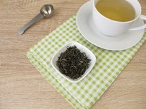 Cup of chinese tea white monkey Stock Photo
