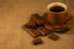 Cup and chocolate. Stand on the table cover with sacking Royalty Free Stock Images