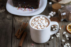 Cup of chocolate drink with marshmallows into small pieces Royalty Free Stock Photo