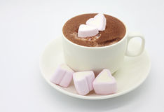 Cup of chocolate with heart shaped marshmallows. Cup of hot chocolate with delicious shugared heart shaped marshmallows. High key picture, white background stock photography
