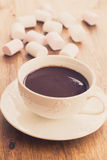 Cup of chocolate with marshmallows on wooden table Stock Image