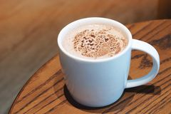 A cup of chocolate milk in the cafe stock photography
