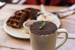 Cup of chocolate mocha with chocolate waffles stock photos