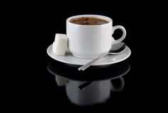 Cup of chocolate, sugar,on a black background. Cup of hot chocolate, sugar, on a black background stock images