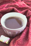 Cup of chocolate on wooden surface Royalty Free Stock Photography