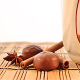 Cup, chocolates and spices Royalty Free Stock Photos