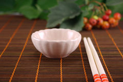Cup and chopsticks Stock Photos