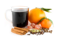 Cup of christmas drink. Mandarin, orange, spice mix for hot wine: kumquats, cinnamon sticks, pimento, cloves, cardamom Royalty Free Stock Photography