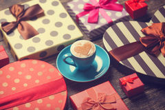 Cup and christmas gifts. Stock Photography
