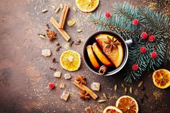 Cup of christmas mulled wine or gluhwein with spices and orange slices on rustic table top view. Traditional drink on winter. Royalty Free Stock Photography