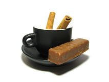 Cup with cinnamon Stock Images