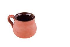 Cup of clay. Handmade clay cup with handle for hot drinks Royalty Free Stock Image