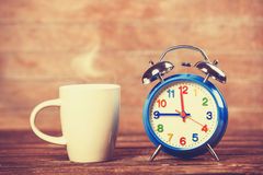 Cup and clock Stock Images