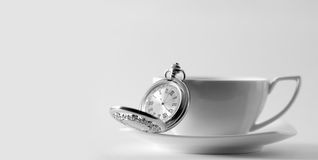 Cup and clock Royalty Free Stock Images