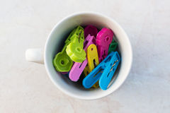 Cup of clothespins. Top view of a cup of clothespins Royalty Free Stock Images