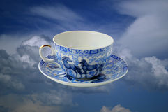 Cup in the clouds. Painted cup, flying in the clouds Royalty Free Stock Photography