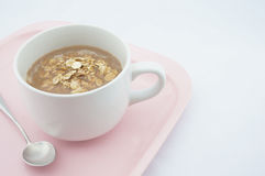 Cup of coco with oats. Placed on pink tray with white background Stock Image