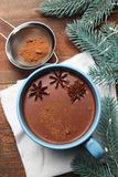 Cup of cocoa with badian. And christmas tree on wooden background. Concept winter drink. Top view stock photo