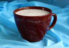 Cup of cocoa. Cup of cocoa on blue background Royalty Free Stock Image