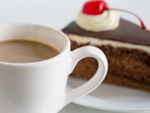 Cup of cocoa and chocolate cake. White cup of cocoa and chocolate cake Stock Images