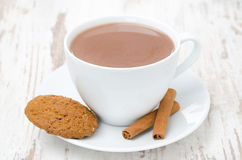 Cup of cocoa with cinnamon and oatmeal cookies Stock Photo