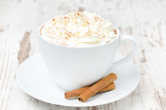 Cup of cocoa with cinnamon and whipped cream Stock Photo