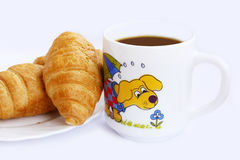 Cup of cocoa and croissants Stock Image